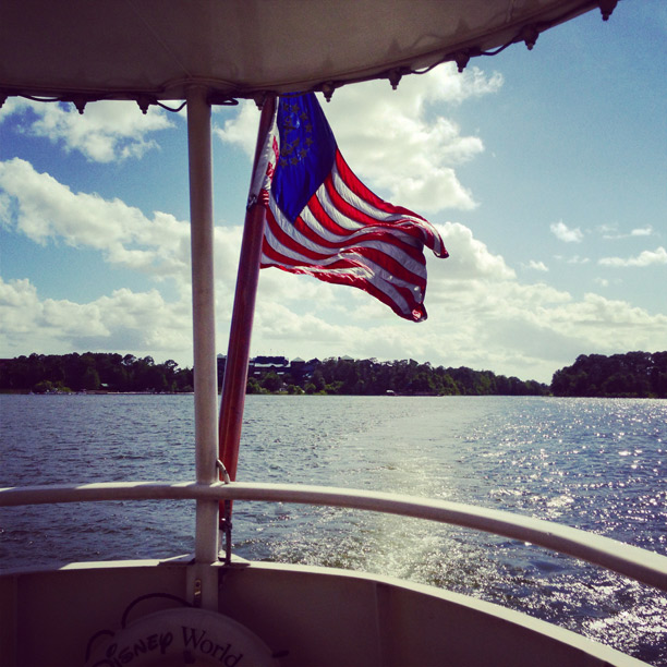 american flag by the water